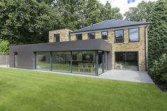 IQ Glass provided glass sliding doors onto the extension for Richmond House to create a large kitchen living space with strong links to the garden.