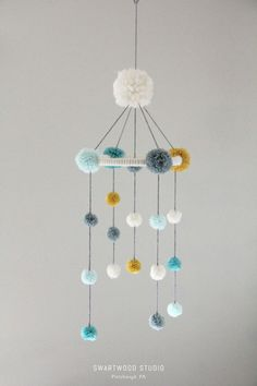Your place to buy and sell all things handmade - Your place to buy and sell all things handmade Baby Pom Mobile in Aquas and Light Mustard by SwartwoodStudio Baby Crafts, Diy And Crafts, Arts And Crafts, Pom Pom Baby, Pom Poms, Diy For Kids, Crafts For Kids, Pom Pom Mobile, Diy Bebe