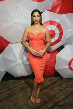 Camila Alves rocked some Target red, posing next to the brand's bullseye in a formfitting dress and Stuart ...