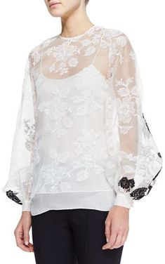 $1,790, Oscar de la Renta Sheer Long Sleeve Lace Blouse White. Sold by Neiman Marcus.