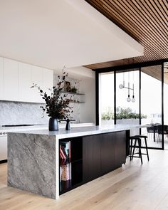 Top 7 glass ball feature lights: Shop the latest lighting trene. Kitchen with timber slat ceiling and solid stone island bench with waterfall edge on one side