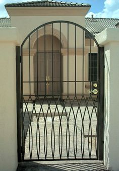 Engaging House Iron Gate Design Featuring Black Color Single Door Iron Gate Convex Shape Gate And Concrete Walkway Front Gates, Entrance Gates, Entrance Design, Front Entry, Front Porch, Door Design Photos, Tor Design, Iron Gate Design, Concrete Walkway