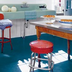 Colorful retro kitchen. Who knew linoleum could look so good? Photo: Tim Street-Porter | thisoldhouse.com | from 28 Thrifty Ways to Customize Your Kitchen
