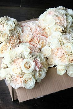 Creams and soft blush bridal bouquets. So pretty. Insert some gemstones into them? THIS IS SO PERFECT! And the flowers to pin to the mom's dresses could have a gemstone in them too. LOVE THIS. GLAM!