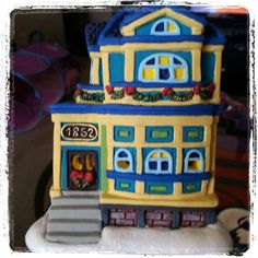 My Apartment building for my Christmas village handed painted by Lauren Brady