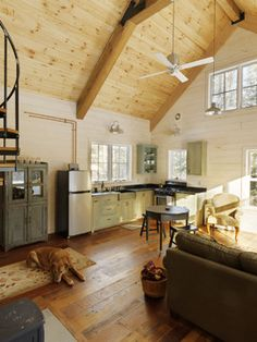 Yellow pine ceiling, white-ish walls.  Winter Cabin - eclectic - family room - burlington - Susan Teare, Professional Photographer