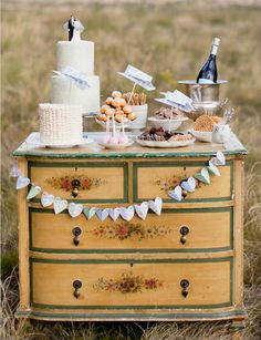 Love the idea of an old dresser for the cake table.  Ideas for Vintage Wedding Decor | French Quarters