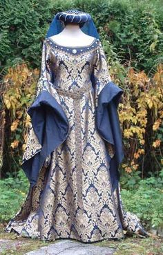 I love the dress!!!! And a married woman would wear the headdress...or an older unmarried woman.