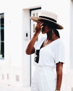 All white with cute straw hat.