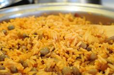 Puerto Rican Rice with Puerto Rican Pork chops Recipe with Great Flavor... Do not add the tomato sauce ever again Julie!!