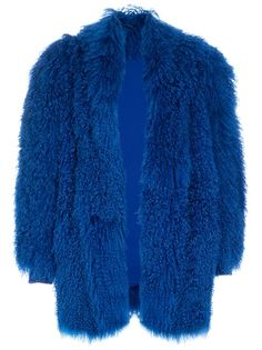 Blue faux fur coat from Italian Tailored Vintage featuring a concealed front fastening, a shawl collar, a long haired wool texture embellishing the coat and ribbed cuffs. Please note that vintage items are not new but often between 20 and 50 years old, and therefore will always have minor imperfections