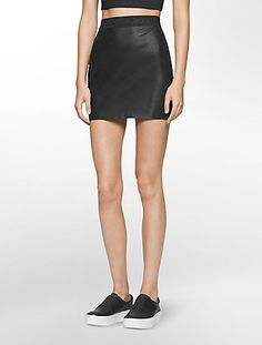 a mini skirt designed with signature logo waistband detailing and faux leather for an edgy, sporty-chic essential.