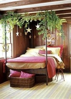 """Delightful! Another person wrote this great idea: """"Don't have a four-poster bed as pictured? Use some cup hooks to attach garland to the ceiling, directly above each side of the bed and hang some stars or ornaments with long ribbon from the branches"""""""