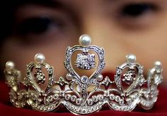 A silver colored crown with Hello Kitty charms on it. couldn't find it for sale but it is cute cute.