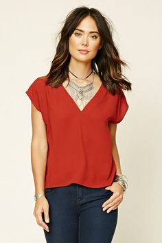 Style Deals - A woven boxy top featuring a V-neckline with a strappy accent, a deep V-back, and short dolman sleeves.