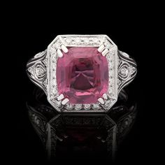Natural Unheated Pink Sapphire for approximately 6.07cts, accented by 60 Round Cut Diamonds for a total approximate weight of 0.56cts in a Platinum Setting. The Sapphire is unheated and has a Cushion Shape with a Modified Brilliant Crown and Step Cut Pavilion. The ring is a size 6.75 and weighs 7.8 grams. GIA report #1146420954 is included.