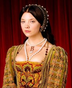 Ahem, Lady Queen, your bosoms are quite exposed. Where is your shift, your chemise, your covers?! This just isn't quite accurate, is it; but it sure is beautiful. LABEL: Anne Boleyn - The Tudors