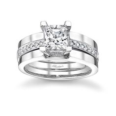 Trio Engagement Ring Set - 7527SW - This bold and contemporary interlocking diamond bridal set features a diamond engagement ring sporting a prong set round diamond center and pave set diamonds running down the shoulders. Two notched bright polished wedding bands are grooved to capture the engagement ring on each side for a bold sophisticated look. Also available in 18k and Platinum.