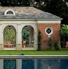 brick Georgian pool pavilion. Gorgeous arches (with a lantern in each) with articulated columns, ribs, and keystones, round window in side wing, heavy cornice, and slate roof complete with demilune dormer window.