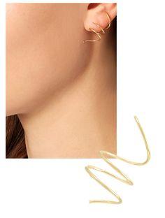 Hooped earrings graphic jewelry trends Charlotte Chesnais Maison Margiela   Vogue Paris#creoles-saturne-charlotte-chesnais