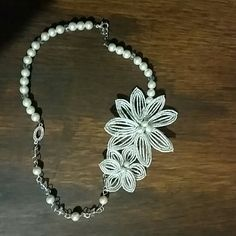 Handmade french beaded flower necklace Marked down!!!Each flower is twisted, molded and shaped. This process takes about 2-3 hours for each flower. Colors are white, silver and clear. Easy to wear and definitely a statement piece.Thanks for looking! Jewelry Necklaces