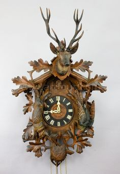 antique black forest carved wood cuckoo clock