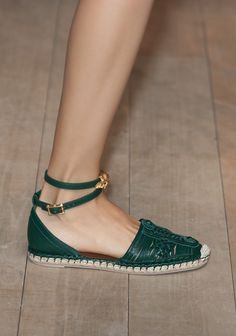 Sexy little espadrilles get a lady-like strap and embellishment from Valentino.