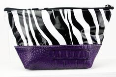 ACEL-ZBLK/PURPLE.  ACEL-ZBLK/RED.  These two-toned Faux Leather cosmetic bags pair perfectly with all your SJO favorite totes ~ perfect for carrying all your makeup or toiletries in!  Never Stains, just wipe clean when your makeup spills or the chocolate bar melts! #sarahjanesoilcloth #love #madeintheusa www.simplysjo.com