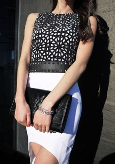 Classic black and white outfit with a twist. My favourite details of the dress are the beautifully laser cut geometric design on top and then moving down to a hi-low hem skirt.