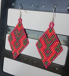 Mexico earrings, Boho earrings, raspberry earrings, National motives, Ethnic peyote earrings, Ethnic style, Boho, Dangle earrings  Bright ethnic earrings. The pattern in the style of Mexican motives Beautiful earrings from Japanese seed beads in the shape of a rhombus. Ethnic style, boho  The colors of beads - crimson, orange, green. matte finish  High-quality Japanese beads Miyuki Delica The original design. my scheme Earrings are lightweight   Length including ear wires - 2.5 / 6.5 cm…