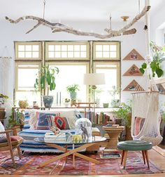 Nothing complements a bohemian space better than a plant — or a whole, whole lot of plants