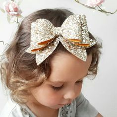 READY TO SHIP in October!! A beautiful OVERSIZED Extra Sparkly & Extra Chunky Glitter Fabric Hair BOW Clip. Securely attached to a strong teethed alligator clip. Bow measure approx. 5 x 3.5 at widest points including tags. **NOW AVAILABLE on headbands too! ** Please choose your
