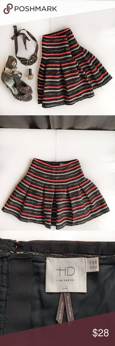 """Anthropologie - HD In Paris - Stripe Skirt Anthropologie's HD In Paris - Black, Grey and Orange Stripe Skirt Size 6 petite Cute pleats throughout the skirt Fun exposed zipper in the back with orange pull  18.5"""" length Lined Polyester/rayon/acrylic/cotton blend  Excellent condition   Brand new sequin heels from Anthropologie are also for sale in size 7.5. Message me for details.   All items come from an extremely clean and organized house - my mom taught me well!!  Non-smoker. No pets.  No…"""