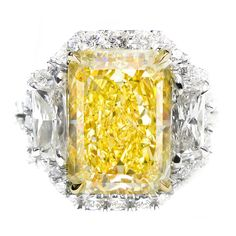 1stdibs | Vibrant GIA Canary 5.01 Carats diamond ring.Vibrant GIA Certified Canary Diamond, featuring 5.01 Carat Radiant cut diamond in the center, Fancy Light Yellow in color (looks like Fancy Yellow), surrounded by 2.50 Carats of diamonds around it. Set in 18K white gold custom made mounting.