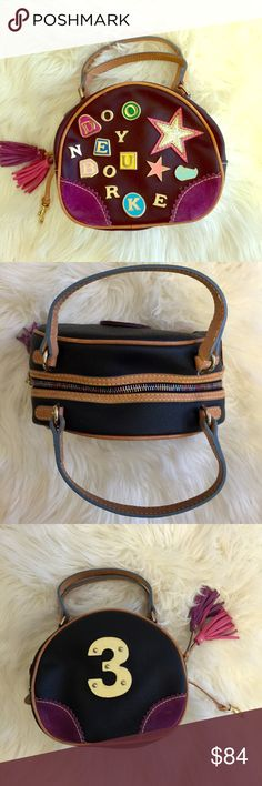 Additional pics of D&B mini charm bowler Dooney & Bourke black leather bowler charm speedy tote # 3   100% authentic. Has a couple of minor scratches but otherwise In mint condition!!! Dooney & Bourke Bags Mini Bags