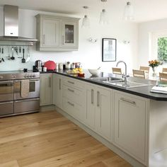 Island as room separator to living room; Contemporary open-plan kitchen