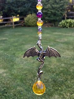 Rear view mirror crystal car charm sun catcher with a double sided pewter dragon and Gold crystal ball prism. Each sun catcher is hand made and truly unique. Sun Catcher, Dream Catcher, Diy Wind Chimes, Garden Totems, Car Rear View Mirror, Silver Dragon, Crystals And Gemstones, Decoration, Art Inspo