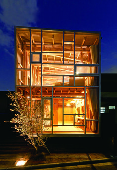 The timber-framed rooms of this house in Osaka prefecture are on show to the street though a transparent facade »