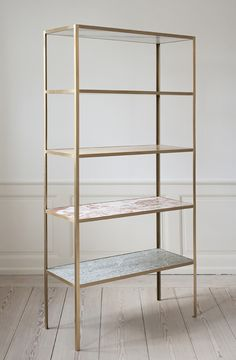 Marble bookshelf by Muller Van Severen