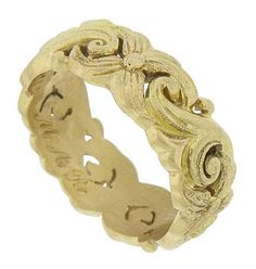 "Bold abstract floral cutwork and vines spin across the surface of this antique 18K yellow gold wedding band. Inscribed with scrolling engraving ""M A R"". The Victorian wedding ring measures 6.86 mm in width. Circa: 1880. Size 6 1/2"