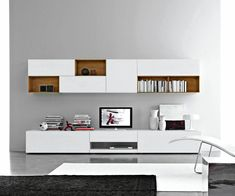 Modern TV wall made of sustainable solid wood on Behance Solid Wood Desk, Solid Wood Shelves, Massive Holzregale, Lcd Panel Design, Modern Tv Wall, Living Room Entertainment Center, Tv Unit Design, Wall Mounted Tv, High Quality Furniture