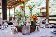 Rustic Wedding Centerpieces by Flowers at the House-Orange and Green Delamater House Wedding-New Smyrna Wedding Venue- Photo: Liz Cowie Photography-Orange Blossom Bride-Central Florida Wedding Blog-www.orangeblossombride.com