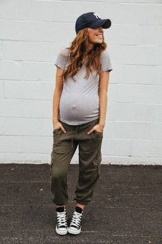 Sporty maternity bump. Pregnancy casual style.
