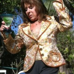 "Vintage look Gold Jacket. Shimmery silver and gold tone vintage look jacket.  Fully lined in gold tone. The entire coat is trimmed in velvet, with velvet bow detail at end of sleeves and on pockets. Three big button closure.  21"" from top of shoulder to bottom of coat. 26"" sleeve length. 18"" outside shoulder to shoulder when laying flat. Martini not included :) CE Jackets & Coats"