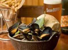 Hopleaf. A warm and cozy interior, great comfort dishes like mussels and frites (sooooo good!), and a huge beer selection make this a perfect winter hideaway.