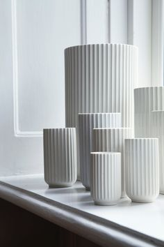The white vases are from the Danish porcelain factory, Lyngby Porcelænsfabrik, and are vintage editions from Everclassic.