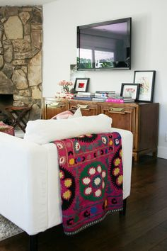 Console table and blanket.
