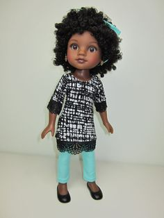 Rahel is so cute in her new outfit! She is wearing a black and white print sweater tunic top with a lace edge hem . The soft sweater tunic top has short sleeves with a lace hem , and a lace hemline. she has paired her tunic top with mint green jeggings. The tunic top is made of a soft knit sweater and closes down the back with thin velcro. The jeggings are made of mint green stretch denim and are snug fitting so might need Mom to put them on the doll. the jeggings have a faux fly detai...