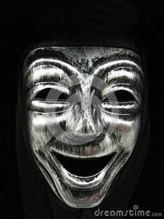 Closeup of a smiling carnival face mask, part of a Halloween costume.