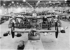 Birth of a Bomber- Aircraft Production in Britain. An impressive view of a row of Halifax bombers being assembled at the Handley Page factory at Cricklewood Air Force Aircraft, Ww2 Aircraft, Military Aircraft, Handley Page Halifax, Lancaster Bomber, History Online, Ww2 Planes, Royal Air Force, The Good Old Days